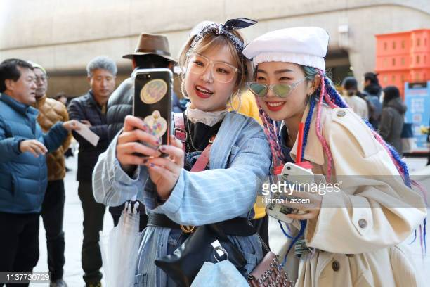 Guest wearing denim trench coat and Gucci belt is seen at the Hera Seoul Fashion Week 2019 F/W at Dongdaemun Design Plaza at Dongdaemun Design Plaza...