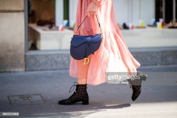 A guest wearing Dior bag and boots is seen outside Ralph Russo on day two during Paris Fashion Week Haute Couture FW18 on July 2 2018 in Paris France