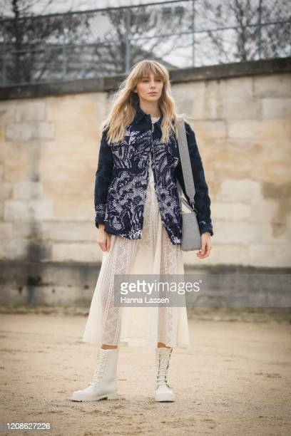 Guest wearing Dior bag, denim jacket and white tulle skirt wearing outside the Dior show as part of the Paris Fashion Week Womenswear Fall/Winter...