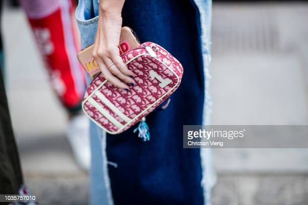 A guest wearing Dior bag is seen outside Natasha Zinko during London Fashion Week September 2018 on September 18 2018 in London England