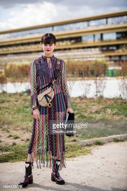 Guest wearing Dior dress and bag is seen before the Christian Dior show on September 24 2018 in Paris France