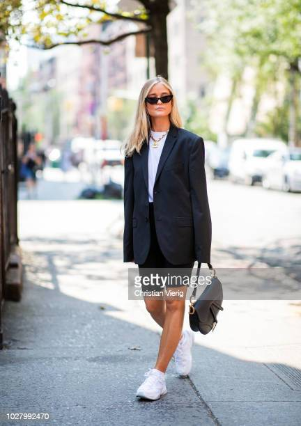 A guest wearing Dior saddle bag sneaker cycle pants is seen outside Collina Strada during New York Fashion Week Spring/Summer 2019 on September 6...