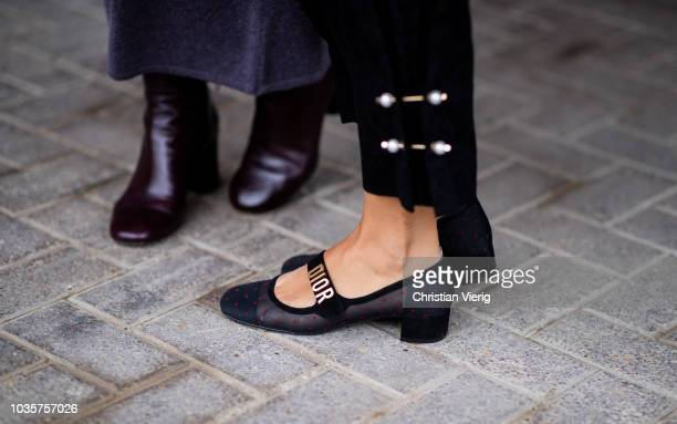 A guest wearing Dior shoes is seen outside Natasha Zinko during London Fashion Week September 2018 on September 18 2018 in London England