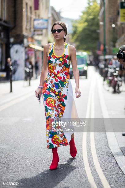 A guest wearing dress with floral print outside Marques Almeida during London Fashion Week September 2017 on September 18 2017 in London England
