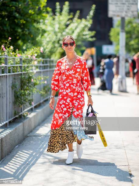 A guest wearing dress with multi prints is seen outside Noon By Noor during New York Fashion Week Spring/Summer 2019 on September 6 2018 in New York...