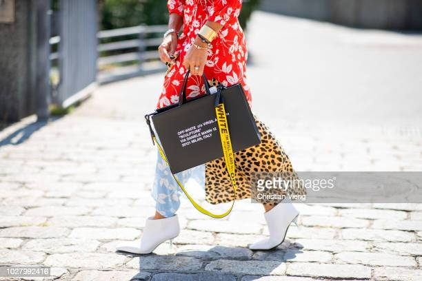 A guest wearing dress with multi prints Off White bag is seen outside Noon By Noor during New York Fashion Week Spring/Summer 2019 on September 6...