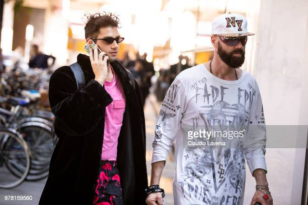 Guest wearing fake fur and Raimondo Rossi wearing white t shirt with stamp, are seen in the streets of Milan before the Giorgio Armani show, during...