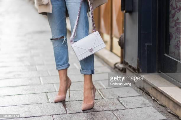 A guest wearing fake fur jacket Dior bag denim jeans heels outside AALTO on February 28 2017 in Paris France
