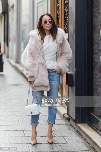 A guest wearing fake fur jacket Dior bag denim jeans heels outside AALTO on February 28 2017 in Paris France