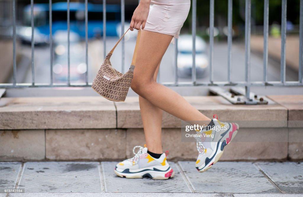 A guest wearing Fendi bag, Balenciaga sneaker is seen during