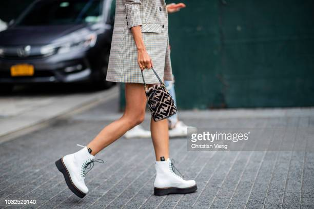 16783c882ec8 A guest wearing Fendi bag is seen outside Michael Kors during New York  Fashion Week Spring