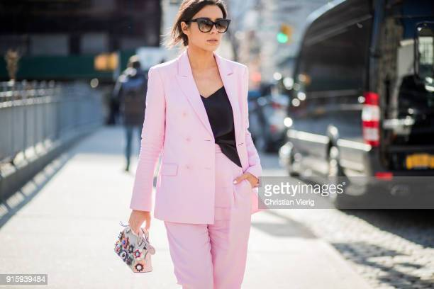 A guest wearing Fendi bag pink suit seen outside Noon By Noor on February 8 2018 in New York City