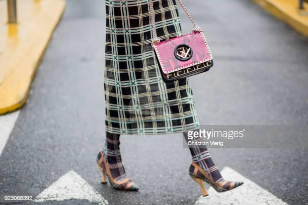 A guest wearing Fendi bag seen outside Fendi during Milan Fashion Week Fall/Winter 2018/19 on February 22 2018 in Milan Italy