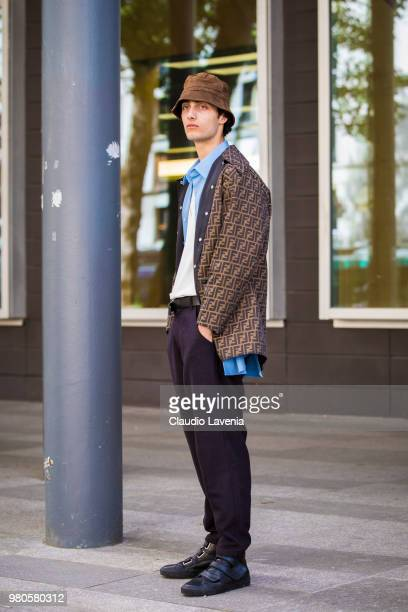 A guest wearing Fendi parka and purple pants is seen in the streets of Paris before the Issey Miyake show during Paris Men's Fashion Week...