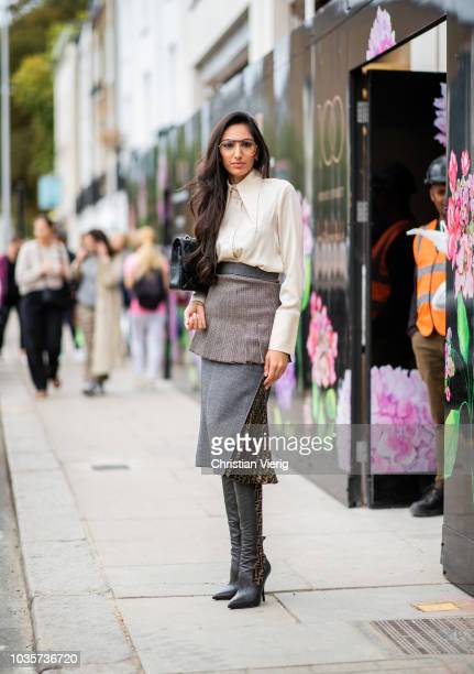 A guest wearing Fendi skirt and boots Chanel bag is seen outside Natasha Zinko during London Fashion Week September 2018 on September 18 2018 in...