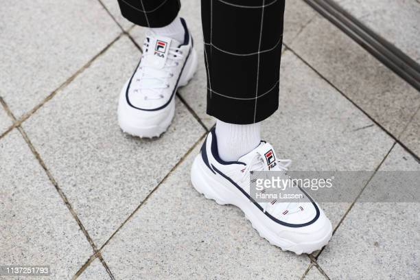 Guest wearing Fila sneakers is seen at the Hera Seoul Fashion Week 2019 F/W at Dongdaemun Design Plaza at Dongdaemun Design Plaza on March 21 2019 in...