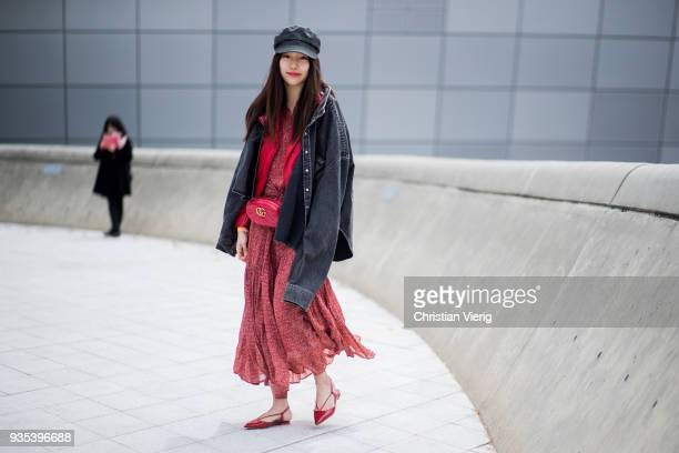 A guest wearing flat cap denim jeans jacket red dress red Gucci fanny bag is seen at the Hera Seoul Fashion Week 2018 F/W at Dongdaemun Design Plaza...