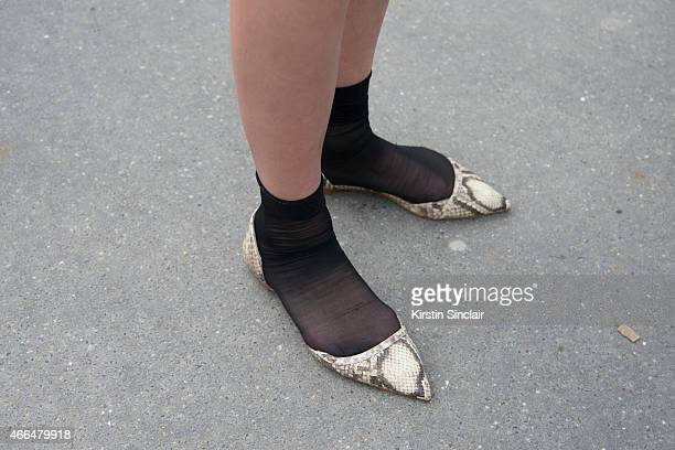 A guest wearing flat shoes and socks on day 7 of Paris Collections Women on March 09 2015 in Paris France