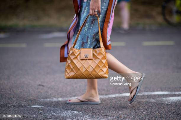 3e02c5a695a1 A guest wearing flip flops and Chanel bag is seen outside MUF10 during the Copenhagen  Fashion