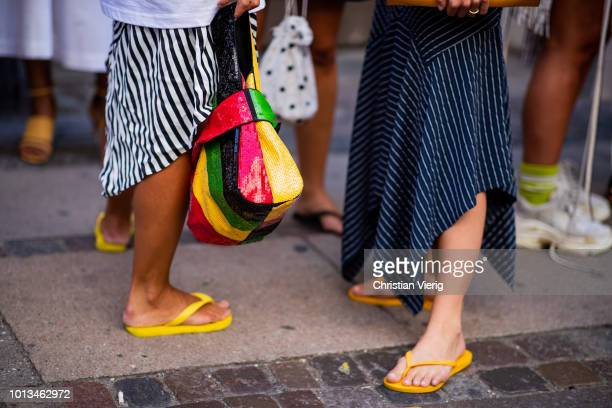 b3fb87556fdf A guest wearing flip flops multi color bag seen outside Rodebjer during the Copenhagen  Fashion Week
