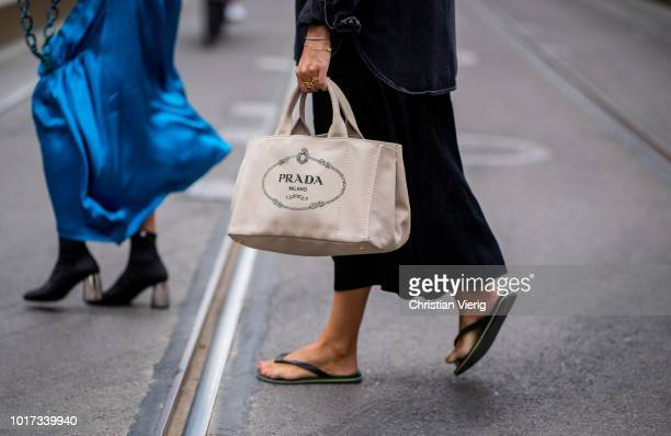 A guest wearing flip flops Prada bag seen outside Pia Tjelta during Oslo Runway SS19 on August 15 2018 in Oslo Norway