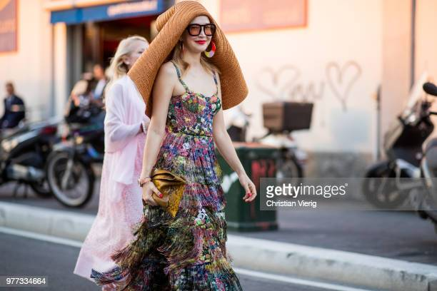 A guest wearing floppy hat is seen outside Dsquared2 during Milan Men's Fashion Week Spring/Summer 2019 on June 17 2018 in Milan Italy
