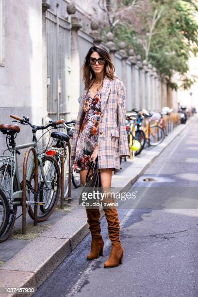 A guest wearing floral dress checked jacket and brown heeled boots is seen before the Sportmax show during Milan Fashion Week Spring/Summer 2019 on...