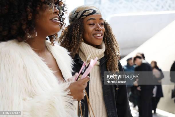 Guest wearing floral printed bandana denim jacket and faux fur jacket is seen at the Hera Seoul Fashion Week 2019 F/W at Dongdaemun Design Plaza at...