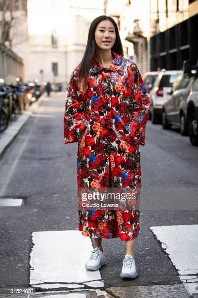 Guest wearing flower print trench coat is seen outside Blumarine on Day 3 Milan Fashion Week Autumn/Winter 2019/20 on February 22 2019 in Milan Italy