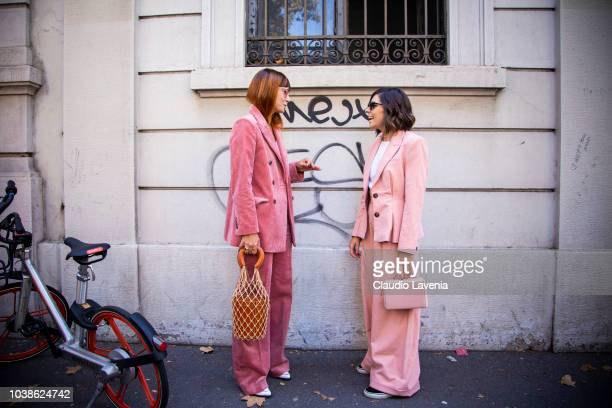 A guest wearing fuchsia suit and a guest wearing pink suit are seen before the Marni show during Milan Fashion Week Spring/Summer 2019 on September...
