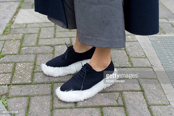 A guest wearing furry trainers on day 3 of London Collections Men on January 11 2015 in London England