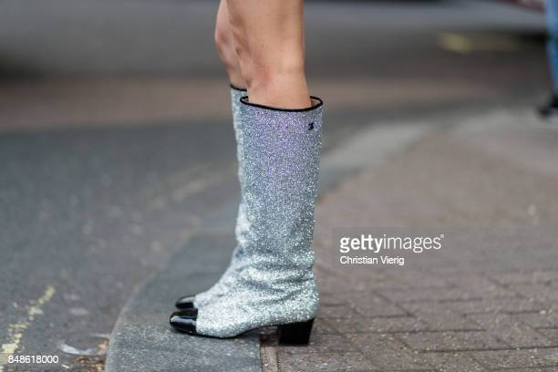 A guest wearing glitter Chanel boots outside Peter Pilotto during London Fashion Week September 2017 on September 17 2017 in London England