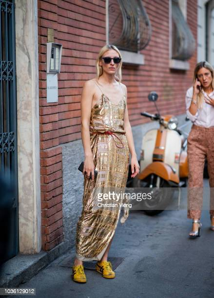 A guest wearing golden dress is seen outside No 21 during Milan Fashion Week Spring/Summer 2019 on September 19 2018 in Milan Italy