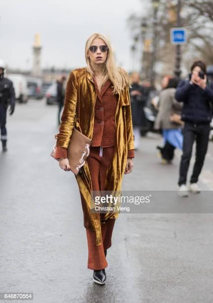 A guest wearing golden velvet coat suit outside Maison Margiela on March 1 2017 in Paris France