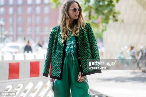 A guest wearing green blazer jacket green jogger pants outside Munthe on August 09 2017 in Copenhagen Denmark