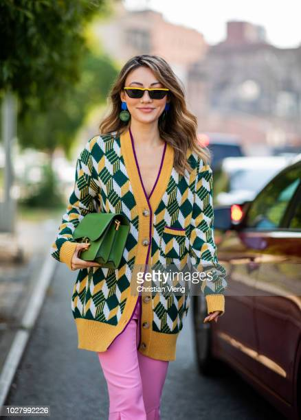 A guest wearing green cardigan pink pants is seen outside Noon By Noor during New York Fashion Week Spring/Summer 2019 on September 6 2018 in New...
