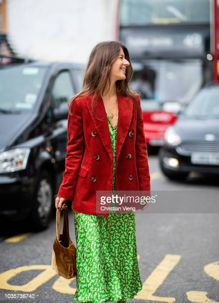A guest wearing green dress red corduroy blazer jacket is seen outside Natasha Zinko during London Fashion Week September 2018 on September 18 2018...