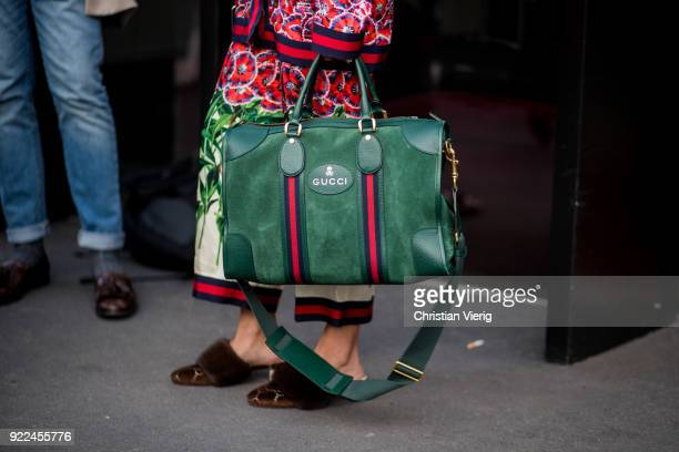 A guest wearing green Gucci bag seen outside Gucci during Milan Fashion Week Fall/Winter 2018/19 on February 21 2018 in Milan Italy