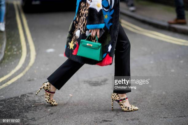 A guest wearing green Hermes bag heels with leopard print seen outside Mulberry during London Fashion Week February 2018 on February 16 2018 in...