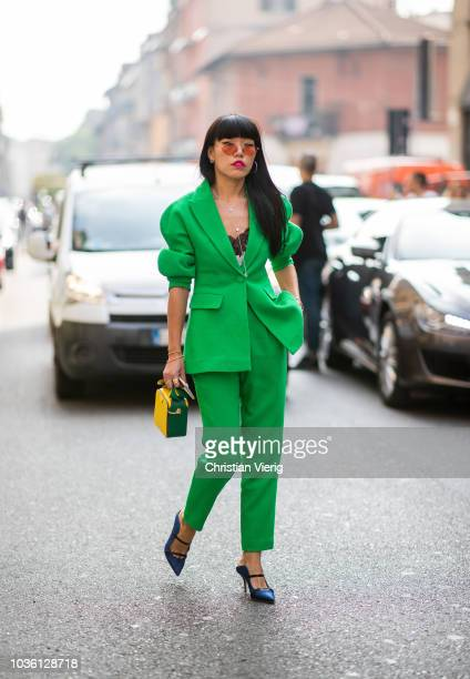 A guest wearing green suit is seen outside Jil Sander during Milan Fashion Week Spring/Summer 2019 on September 19 2018 in Milan Italy