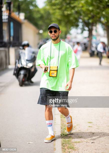 A guest wearing green tshirt and shorts is seen outside Balmain on day six of Paris Fashion Week Menswear SS19 on June 24 2018 in Paris France