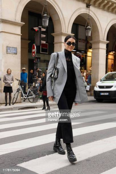 Guest wearing grey blazer and combat boots outside Giambattista Valli during Paris Fashion Week Womenswear Spring Summer 2020 on September 30, 2019...