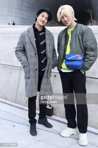Guest wearing grey check coat Balenciaga jumper and black jeans is seen at the Hera Seoul Fashion Week 2019 F/W at Dongdaemun Design Plaza at...