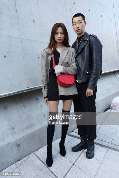 Guest wearing grey check jacket and knee high sock boots with red leather bag is seen at the Hera Seoul Fashion Week 2019 F/W at Dongdaemun Design...