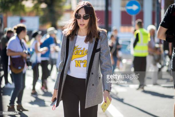 A guest wearing grey checked blazer is seen outside Gucci during Milan Fashion Week Spring/Summer 2018 on September 20 2017 in Milan Italy