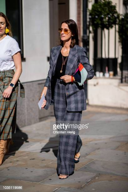 A guest wearing grey checked suit is seen outside Emilia Wickstead during London Fashion Week September 2018 on September 17 2018 in London England