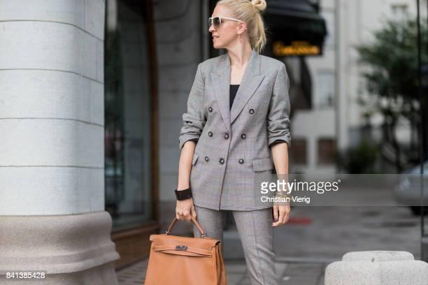 A guest wearing grey suit brown Hermes bag outside Ida Sjoestedt on August 31 2017 in Stockholm Sweden