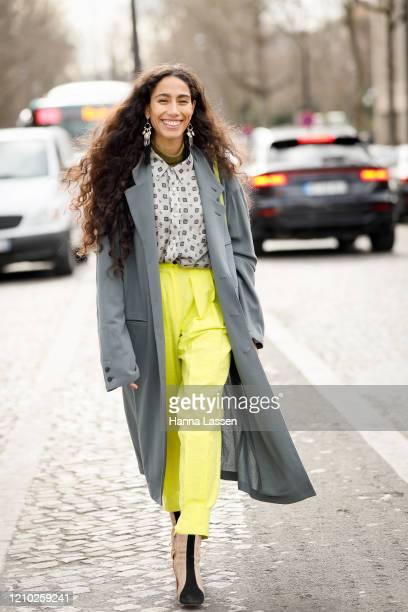 Guest wearing grey trench, neon yellow pant and neon green bag outside the Miu Miu show during Paris Fashion Week Womenswear Fall/Winter 2020/2021...