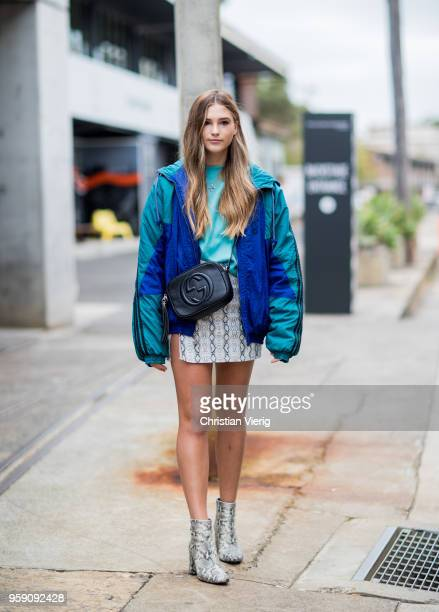 A guest wearing Gucci bag Adidas jacket snake skin mini skirt and ankle boots during MercedesBenz Fashion Week Resort 19 Collections at Carriageworks...
