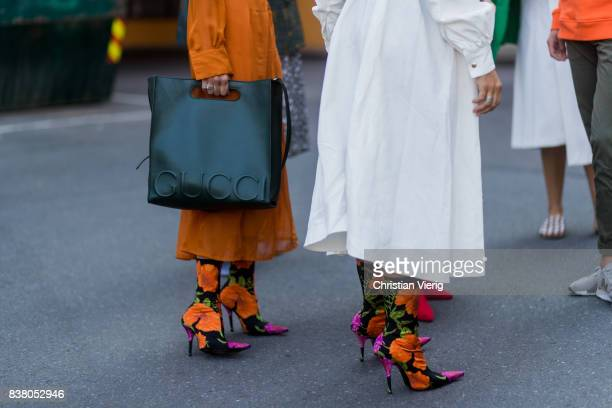 A guest wearing Gucci bag and Balenciaga sock boots with floral print outside FWSS on August 23 2017 in Oslo Norway